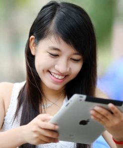 Asian female student on tablet taking online course