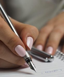 female hands with pink nail polish writing with pen Writing the College Application Essay online course on Luma Learn