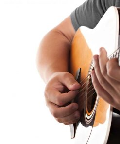 Closeup of a mans hands strumming and electric acoustic guitar isolated over a white background online course on luma learn