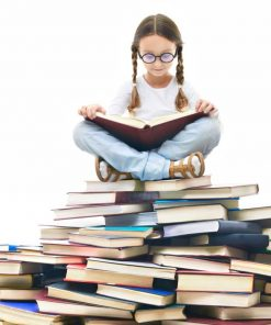 a girl sitting atop a pile of books reading for online course n luma learn