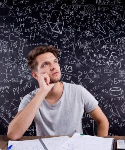 Hipster student doing his homework against a big blackboard for online course on luma learn