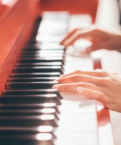 Young beautiful caucasian girl playing piano for music online course on luma learn