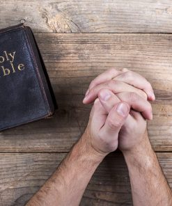 Bible and praying hands for online course in apologetics on luma learn