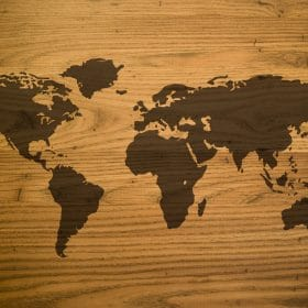 wooden map of the world used in online course on luma learn