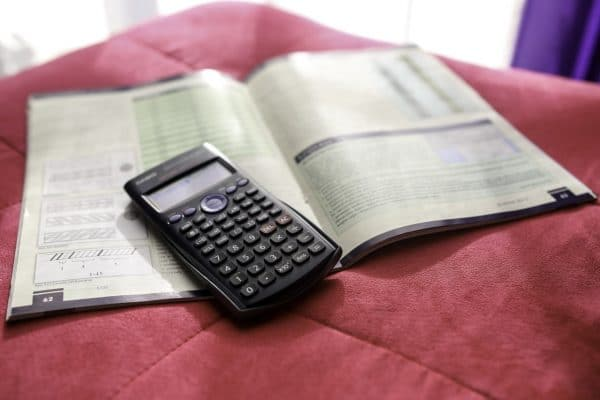 calculator with accounting book for accounting online course on luma learn