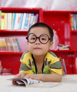 young boy with big glasses used in an online course on luma learn