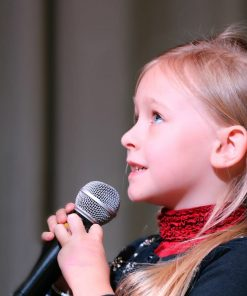 young girl singing for music online course on luma learn