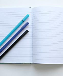 open notebook with pens for writing online course on Luma Learn