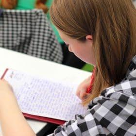 female homeschool student taking online course on luma learn