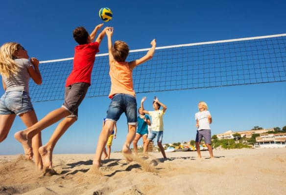 Socialization is a concern for homeschool families. In reality though homeschool children, like these ones playing volleyball are more socialized than their peers in traditional school.